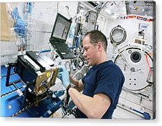 Astronaut Cleaning Iss Lab Equipment Acrylic Print by Nasa