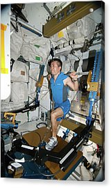 Astronaut Exercising On The Iss Acrylic Print by Nasa