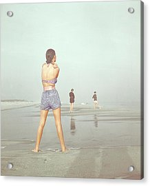 Back View Of Three People At A Beach Acrylic Print