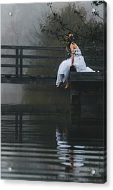 Barefoot Bride In White Wedding Dress Sitting On A Jetty At A La Acrylic Print by Leander Nardin