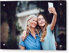 Beautiful Mature Mother And Adult Daughter Taking Selfies Together Acrylic Print by Wundervisuals