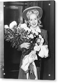 Betty Grable With Flowers Acrylic Print by Underwood Archives