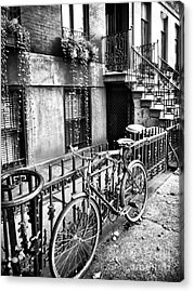Bicycle In The Village Acrylic Print by John Rizzuto