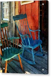 Blue Chair Against Red Door Acrylic Print by Susan Savad