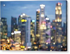 Blurred View Of City Skyline Lit Up At Acrylic Print by Jacobs Stock Photography Ltd