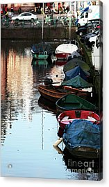 Boats In The Red Light District Acrylic Print by John Rizzuto