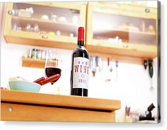 Bottle Of Red Wine On A Kitchen Table Acrylic Print by Wladimir Bulgar