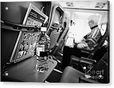 Bottle Of Water On Tray Table Interior Of Jet2 Aircraft Passenger Cabin In Flight Acrylic Print by Joe Fox