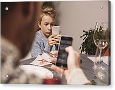 Boy Playing With His Smartphone After Christmas Dinner Acrylic Print by Westend61
