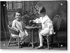 Boy Pours Sister A Cup Of Tea Acrylic Print by Underwood Archives
