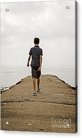 Boy Walking On Concrete Beach Pier Acrylic Print by Edward Fielding