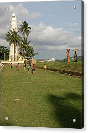 Boys Playing Cricket, Galle Lighthouse Acrylic Print by Panoramic Images