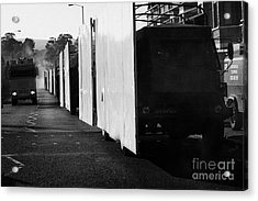 British Army Screen Bedford Trucks And Psni Water Canon On Crumlin Road At Ardoyne Shops Belfast 12t Acrylic Print by Joe Fox