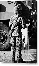 British Army Soldier In Riot Gear With Sa80 In Front Of Saxon Vehicle On Crumlin Road At Ardoyne Sho Acrylic Print by Joe Fox