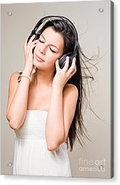 Brunette Immersed In Music Wearing Headphones. Acrylic Print by Alstair Thane