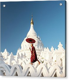 Buddhist Monk Walking Across Arches Of Acrylic Print by Martin Puddy