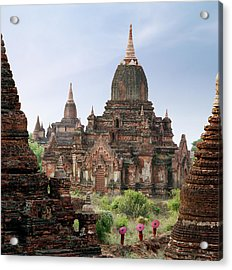 Buddhist Monks Walking Past Temple Acrylic Print by Martin Puddy