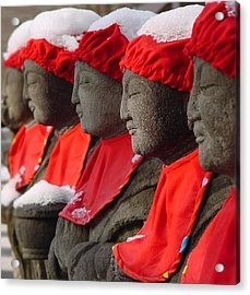 Buddhist Statues In Snow Acrylic Print by Larry Knipfing