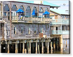 Building On Piles Above Water Acrylic Print by Lorna Maza