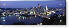 Buildings Along A River Lit Up At Dusk Acrylic Print