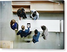 Business Colleagues Discussing Project In Office Acrylic Print by Thomas Barwick