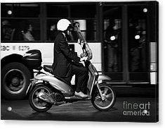 Business Man In Suit And White Helmet On Scooter Commutes Past Bus Full Of Passengers Through Piazza Acrylic Print by Joe Fox