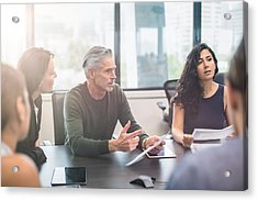 Business People On A Meeting At The Office Acrylic Print by Xavierarnau