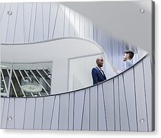 Businessmen Talking On Architectural, Modern Office Balcony Acrylic Print by Caiaimage/Martin Barraud
