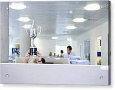 Businesswoman Holding Trophy Over Office Cubicle Acrylic Print by Jacobs Stock Photography Ltd