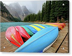 Canoes Line Dock At Moraine Lake, Banff Acrylic Print by Wildroze