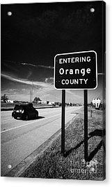 Car Entering Orange County On The Us 192 Highway Near Orlando Florida Usa Acrylic Print by Joe Fox