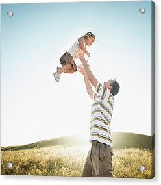 Caucasian Father Lifting Daughter Acrylic Print by Erik Isakson