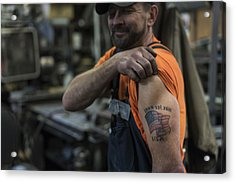 Caucasian Worker Displaying Tattoo In Factory Acrylic Print by Jetta Productions Inc