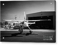 Cessna U206g Fixed Wing Single Engine Seaplane In Front Of Hangar Key West International Airport Flo Acrylic Print by Joe Fox