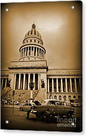 Changing A Tire In Front Of The Capitol Building In Havana Acrylic Print by John Malone