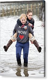 Children Wade Through Flood Waters Acrylic Print by Ashley Cooper