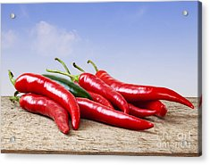 Chilli Peppers On Rustic Background Acrylic Print