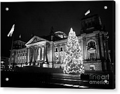 christmas tree and german flag flying fluttering on flagpole outside reichstag building Berlin Germany Acrylic Print by Joe Fox