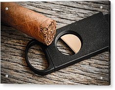 Cigar And Cigar Cutter On Rustic Wood Background Acrylic Print