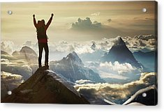 Climber Standing On A Mountain Summit Acrylic Print by Buena Vista Images