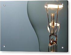 Close Up Glowing Light Bulb Acrylic Print by Bernie_photo