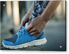 Close-up Of Woman Tying Shoelace On Bench Acrylic Print by Maskot
