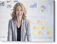 Confident Businesswoman Against Whiteboard Acrylic Print by Xavierarnau