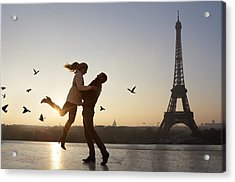 Couple Embracing, View Of Eiffel Tower Acrylic Print by Peter Cade