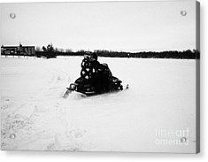 couple on a snowmobile going cross country Kamsack Saskatchewan Canada Acrylic Print by Joe Fox