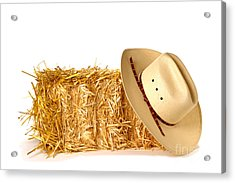 Cowboy Hat On Straw Bale Acrylic Print by Olivier Le Queinec
