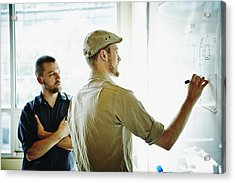 Coworkers Working On Project On Whiteboard Acrylic Print by Thomas Barwick