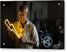 Craftsmen Holding A Lightning Bolt Shaped Neon Light Acrylic Print by Trevor Williams