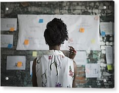 Creative Businesswoman Brainstorming, Reviewing Flow Chart Hanging On Brick Wall In Office Acrylic Print by Hero Images