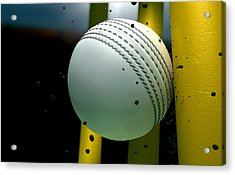 Cricket Ball Striking Wickets With Particles At Night Acrylic Print by Allan Swart